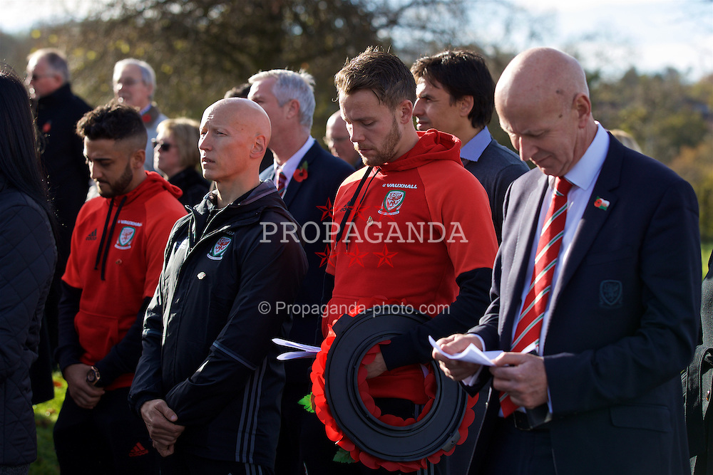 CARDIFF, WALES - Sunday, November 13, 2016: Wales' Neil Taylor, physiotherapist Paul Harris, Chris Gunter and head of pubic affairs Ian Gwyn Hughes at the Pontyclun war memorial on Remembrance Sunday to remember those that lost their lives in the two Great Wars. (Pic by David Rawcliffe/Propaganda)