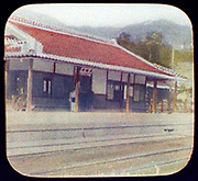 Railway station, Japan, 1895. Hand-coloured lantern slide