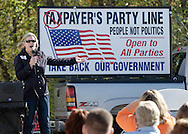 Middletown, New York - Orange/Sullivan County 912 Tea Party co-organizer Sheryl Thomas speaks at the start of a forum with Republican gubernatorial candidate Carl Paladino in the parking lot outside party headquarters on Oct. 9, 2010.