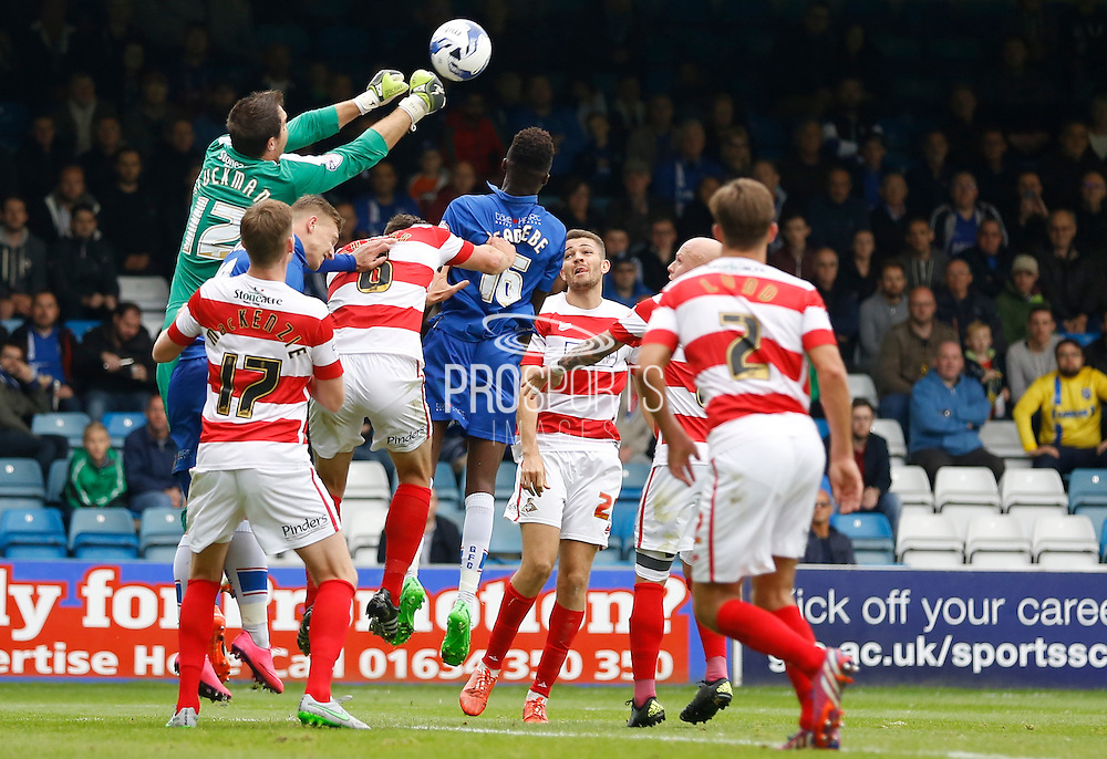 Thorsten Stuckmann punches the ball clear from a crowded penalty box during the Sky Bet League 1 match between Gillingham and Doncaster Rovers at the MEMS Priestfield Stadium, Gillingham, England on 5 September 2015. Photo by Andy Walter.