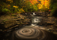 Swirling pattern in duck brook, long exposure, autumn color, Acadia National Park, Maine, USA