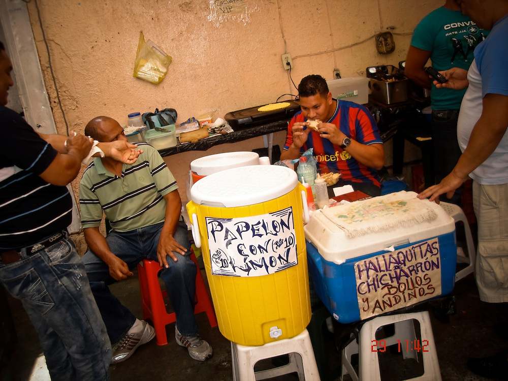 Prisoners sell food inside La Planta prison in Caracas, Venezuela. Prisoners can choose from inmate-run restaurants serving pizza, hamburgers, empanandas, arepas, schwarma and fried fish. Other inmates walk around the prison with trays, offering slices of cake for sale. But prisoners said that the apparent freedom within captivity is a bitter illusion that points to the inability of prison authorities to provide for their most basic needs and personal safety. Prisoner-run restaurants thrive, they said, because the state did not provide adequate food.