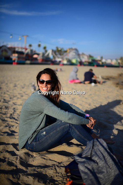 Young woman in Santa Cruz State beach, California.