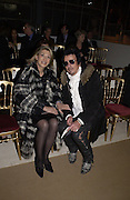Susan Gutfreund and Nicky Haslam. Yves St. Laurent. last couture collection, 1962-2002. Pompidou Centre. Paris. 22 January 2002. © Copyright Photograph by Dafydd Jones 66 Stockwell Park Rd. London SW9 0DA Tel 020 7733 0108 www.dafjones.com