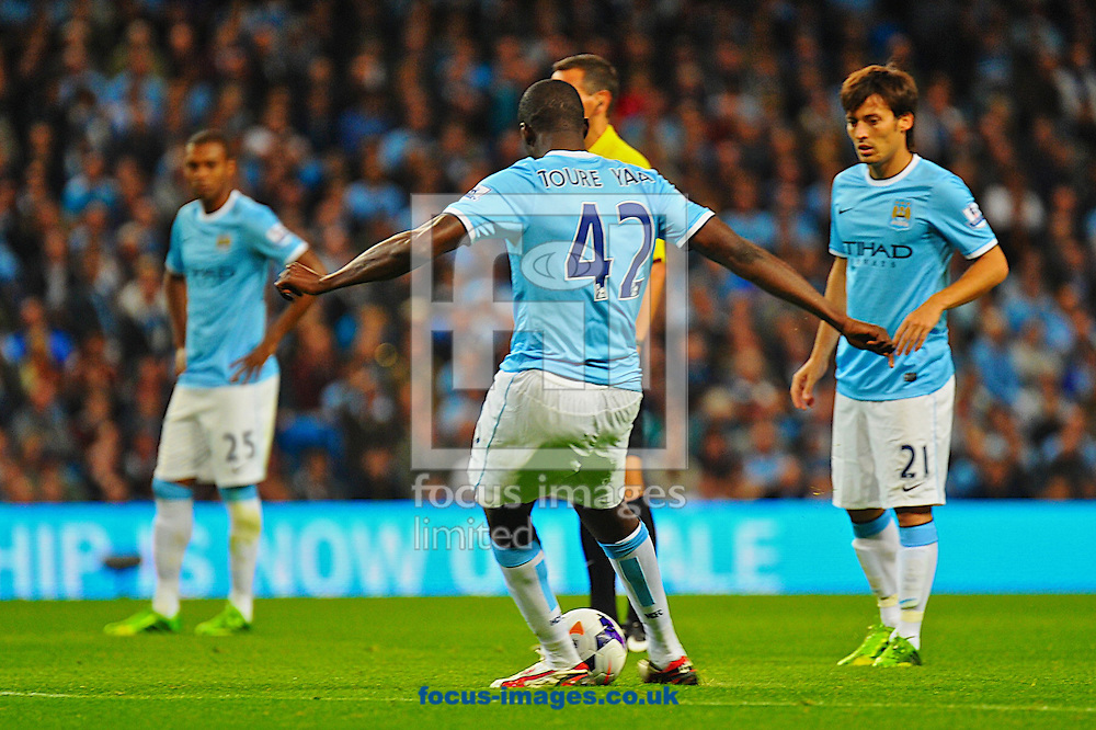 Picture by Ian Wadkins/Focus Images Ltd +44 7877 568959<br /> 19/08/2013<br /> Yaya Tour&eacute; of Manchester City strikes a free kick to make it 3-0 during the Barclays Premier League match at the Etihad Stadium, Manchester.