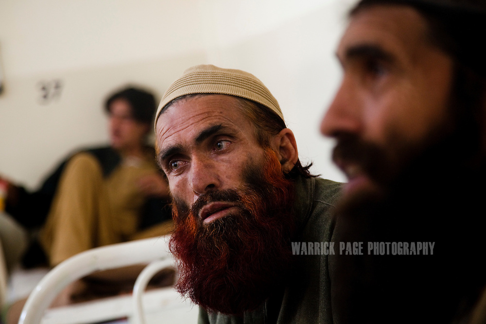 ISLAMABAD, PAKISTAN - FEBRUARY 17: Resham Khan (C), sits on his hospital bed next to his brother, Mulaqat Khan (R), in PIMS Hospital, on February 17, 2011, in Islamabad, Pakistan. Fifteen members of Khan's extended family and dozens of others were killed in what he said was a U.S. drone aircraft strike on a funeral procession last year. Khan suffers from severe mental trauma after seeing the incident take place. Since 2004, the CIA has waged warfare from the skies over tribal regions of Pakistan, with hundreds of strikes killing an estimated 1800-3500 with nearly 50% of those killed being civilian, according to the Bureau of Investigative Journalism. The CIA contests this saying 600 militants have been killed since May 2010, with no civilian casualties.  (Photo by Warrick Page)