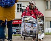 Elderly lady sits while protesting for black lives in matter in Caerphilly during the Black Lives Matter protest in Caerphilly, Wales on 6 June 2020.