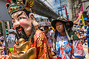 "05 JULY 2014 - BANGKOK, THAILAND: Chinese style dancers on Sukhumvit Road in Bangkok during a parade for vassa. Vassa, called ""phansa"" in Thai, marks the beginning of the three months long Buddhist rains retreat when monks and novices stay in the temple for periods of intense meditation. Vassa officially starts July 11 but temples across Bangkok are holding events to mark the holiday all week.    PHOTO BY JACK KURTZ"