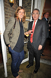 ARABELLA MACMILLAN and ANTHONY BEEVOR at a party to celebrate the publication of Charles Glass's new book 'Americans in Paris' held at 12 Lansdowne Road, London W1 on 25th March 2009.