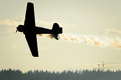 Veteran acrobatic pilot John Mrazek puts his Harvard Mark IV plane through its paces above English Bay prior to the Honda Celebration of Light fireworks program held in Vancouver, British Columbia. Mrazek began flying airplanes in 1964 in Czechoslovakia and has been performing in airshows since the early 1980s.