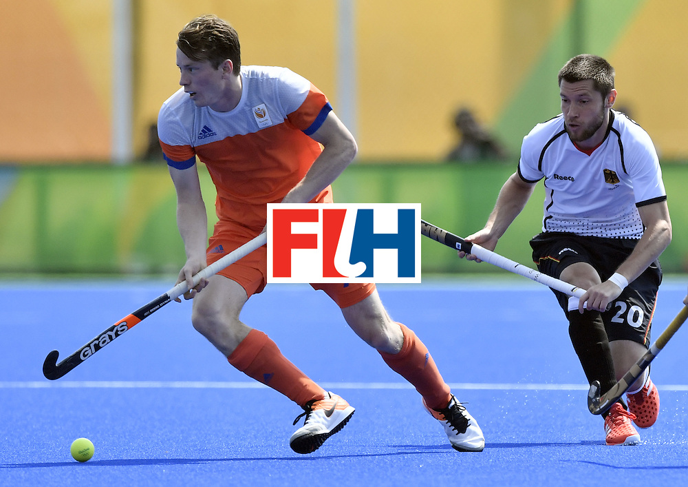 Netherlands' Seve van Ass (L) vies with Germany's Martin Zwicker during the men's Bronze medal field hockey Netherlands vs Germany match of the Rio 2016 Olympics Games at the Olympic Hockey Centre in Rio de Janeiro on August 18, 2016. / AFP / PHILIPPE LOPEZ        (Photo credit should read PHILIPPE LOPEZ/AFP/Getty Images)