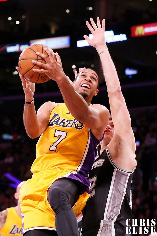 19 March 2014: Los Angeles Lakers forward Xavier Henry (7) goes for the layup over San Antonio Spurs center Tiago Splitter (22) during the San Antonio Spurs 125-109 victory over the Los Angeles Lakers at the Staples Center, Los Angeles, California, USA.