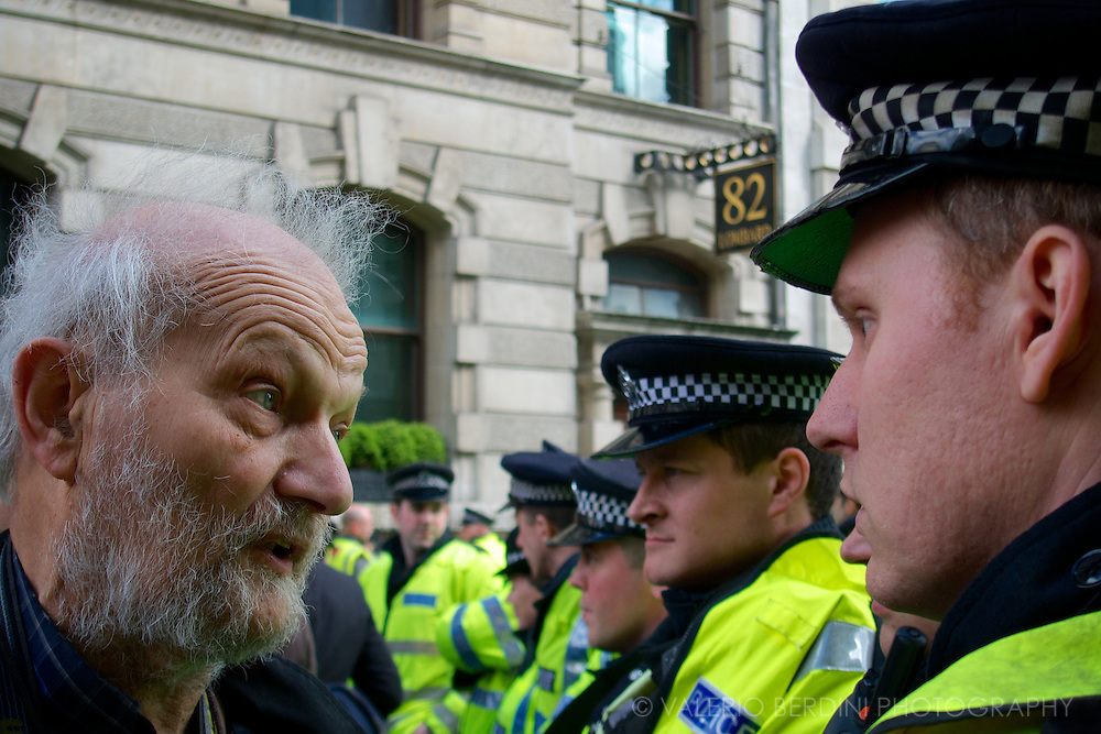 A man faces a police cordon. G20 London Summit Meltdown. Demonstration at the Bank of England on 1st of April 2009.