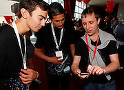 Vodafone Staff help a guest with the Music Awards phone App at the Vodafone VIP Red Zone during the Vodafone New Zealand Music Awards 2011, Vector Arena, Auckland, New Zealand.  Thursday 3 November 2011. Photo: Simon Watts/ Photosport.co.nz
