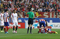 Atletico de Madrid´s player receives a hard tackle during 2014-15 La Liga match at Vicente Calderon stadium in Madrid, Spain. September 27, 2014. (ALTERPHOTOS/Victor Blanco)