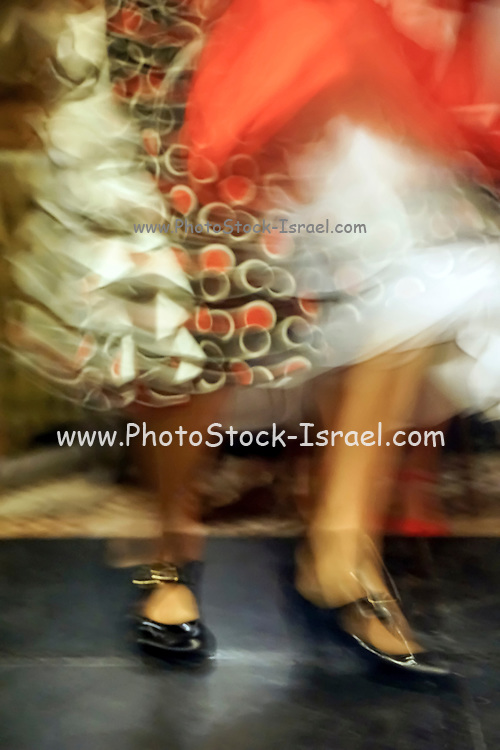 Flamenco dancer legs and feet in motion