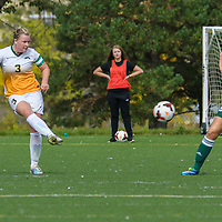 5th year defender Kayla McDonald (3) of the Regina Cougars makes a pass during the Women's Soccer Homeopener on September 10 at U of R Field. Credit: Arthur Ward/Arthur Images