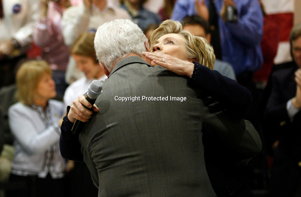 Former U.S. President Bill Clinton hugs his wife U.S. Democratic Presidential candidate Senator Hillary Clinton (D-NY) after introducing her during a campaign stop in Mt. Pleasant, Iowa December 26, 2007. Photo By Keith Bedford