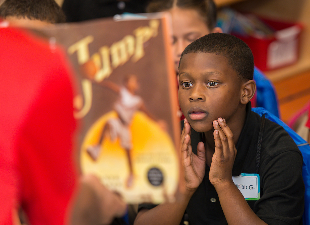Students listen to University of Houston basketball coach Kelvin Sampson read during the Read for the NCAA Final Four kick-off at Blackshear Elementary School, September 24, 2015.