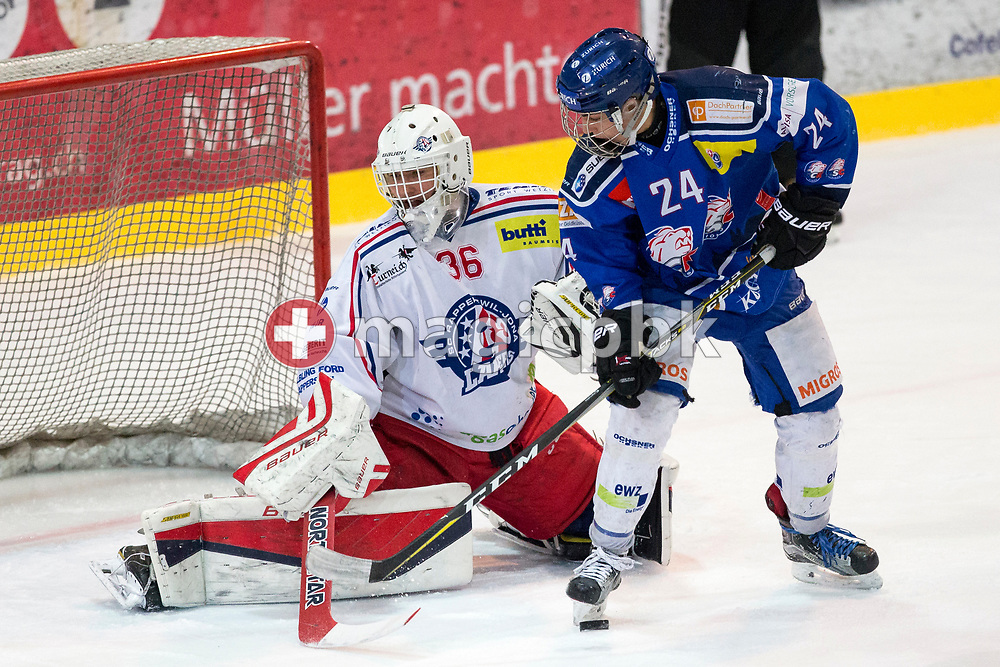 Rapperswil-Jona Lakers goaltender Beat Trudel (L) and ZSC Lions forward Noah Zimmermann battle for possession during the fourth Elite B Playoff Final ice hockey game between ZSC Lions and Rapperswil-Jona Lakers in Duebendorf, Switzerland, Friday, Mar. 17, 2017. (Photo by Patrick B. Kraemer / MAGICPBK)