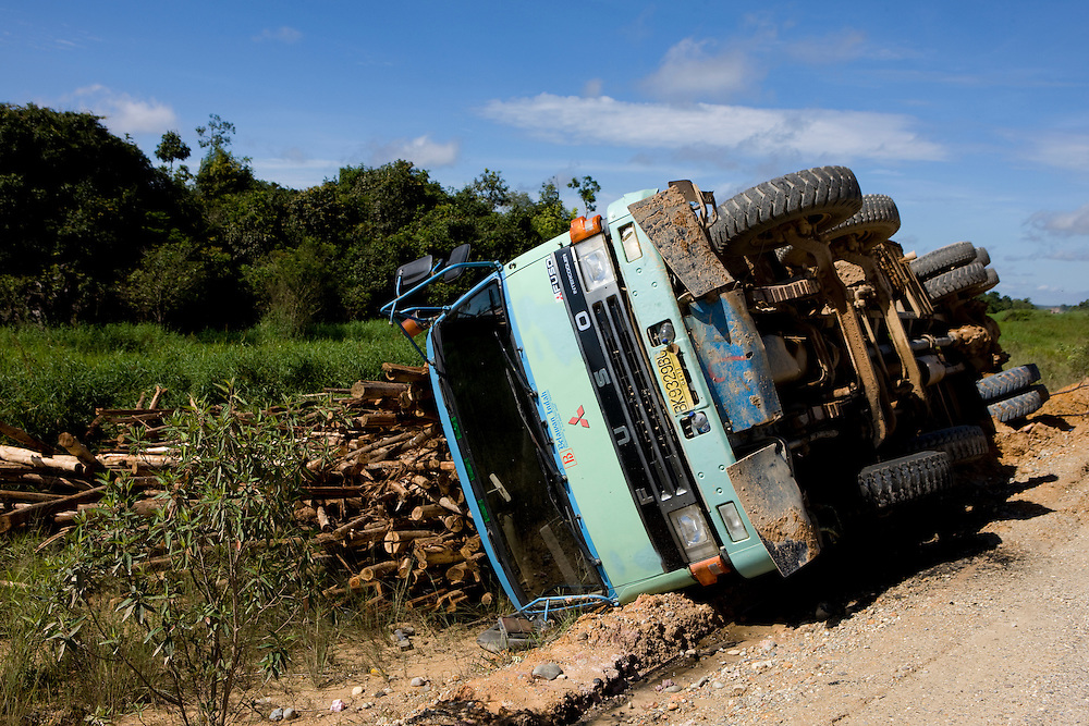 A truck loaded with Acacia wood overturned on the road to Tesso Nilo National Park, Indonesia. Plantations of Acacia trees are used for pulp and paper plants, Aug. 28, 2008..Daniel Beltra/Greenpeace