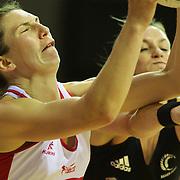 Rachel Dunn, England, (left) is challenged by Leana de Bruin, during the New Zealand V England, New World International Netball Series, at the ILT Velodrome, Invercargill, New Zealand. 6th October 2011. Photo Tim Clayton...