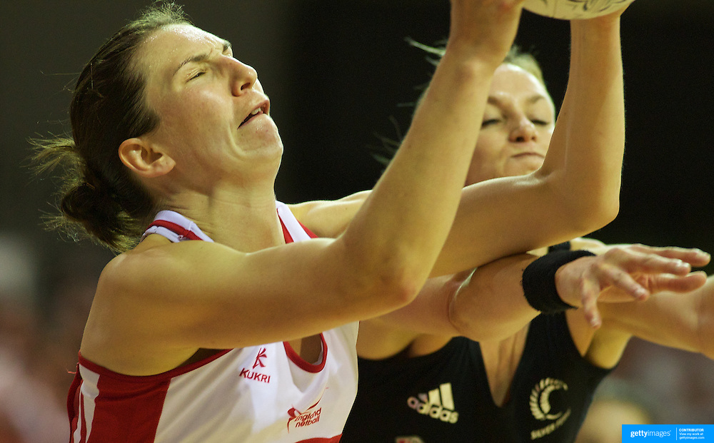 Rachel Dunn, England, (left) is challenged by Leana de Bruin, during the New Zealand V England, New World International Netball Series, at the ILT Velodrome, Invercargill, New Zealand. 6th October 2011. Photo Tim Clayton...