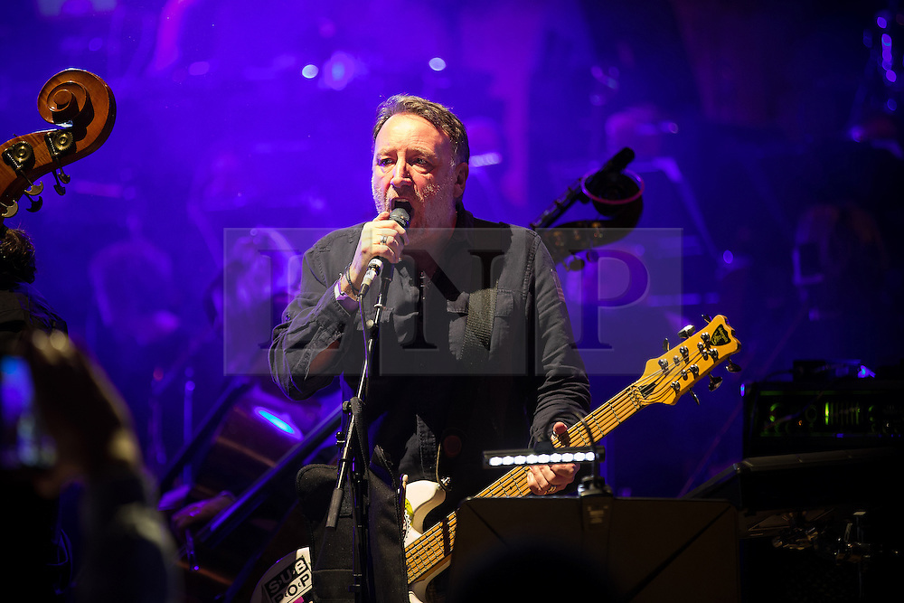 "© Licensed to London News Pictures . 05/02/2016 . Manchester , UK . PETER HOOK . "" Hacienda Classical "" debut at the Bridgewater Hall . The 70 piece Manchester Camerata and performers including New Order's Peter Hook , Shaun Ryder , Rowetta Idah , Bez and Hacienda DJs Graeme Park and Mike Pickering mixing live compositions . Photo credit : Joel Goodman/LNP"
