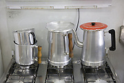 Aluminium coffee pots on a stove in Cubatão town hall