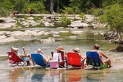 Women relaxing in the Blanco River at Wimberley, Texas