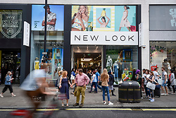 © Licensed to London News Pictures. 13/06/2018. LONDON, UK.  People pass by the New Look store near Oxford Circus.  The New Look fashion chain has incurred an annual loss of nearly £235m. with sales down 12% to £1.3bn in the year to 24 March.  The company has launched a company voluntary arrangement (CVA), to save property rental costs and restructure with up to 60 of its 593 stores, including the one near Oxford Circus, expected to close.  House of Fraser, recently announced that its Oxford Street flagship will close, also as part of CVA restructuring plan. Photo credit: Stephen Chung/LNP