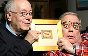 "Jim Millaway and Gailard Sartain hold a framed matchbox cover that helped inspire the name of Sartain's character ""Dr. Mazeppa Pompazoidi"" from their 70's late night local Tulsa, OK, TV show ""The Uncanny Film Festival and Camp Meeting""."