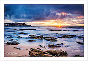 This sunrise brought a warm burst of colour to Bondi Beach between rain showers on a steamy February morning [Bondi Beach, NSW]<br />