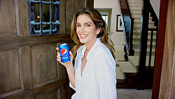"""August 16, 2017 - Malibu, Etats-Unis - Supermodel Cindy Crawford shows off her stunning Malibu home – and shows off a naked photo of herself which decorates her study.Cindy, 52, shares the amazing home with husband Rande Gerber and their two children.She allowed a camera from fashion bible Vogue magazine to share with the world her very desirable residence for the latest instalment of its 73 Questions series.Cindy was interviewed by Joe Sabia and treated him to coffee on the terrace with amazing ocean views.She later led him into her office, which is adorned with memorable shots taken throughout her career. One, taken by star photographer Annie Leibovitz, shows Cindy posing naked with a snake as Eve in the Garden Of Eden. But Cindy admitted although the photo was great, the shoot was not all that fun.She explained:"""" That was, like, my first and only shoot with a snake. """"First of all, it was heavy. Secondly, it smelled disgusting. """"And thirdly, it got a little too friendly.""""Cindy revealed her favourite photo of herself was capture by Helmut Newton for Vogue in Saint Tropez.It shows her in a swimsuit posing against a tree. Newton gave her a print and signed it: """"For the fairest in the land.""""The mother of two, who showed off her children's artwork framed in their kitchen, got a little help from her 15-year-old daughter Kaia Gerber during the interview.Kaia, who is a model herself, stepped into the kitchen, to grab a snack from the fridge.Later Kaia was seen reading on a sofa and Cindy leaned over to kiss the top of her head.Sabia asked Cindy if she had any nicknames for her Kaia and her18-year-old brother Presley .Kaia chimed in: """"She calls me Kiki and my brother P.""""Cindy was asked if her children have any nicknames for her, and Kaia cheekily replied: """"Not that we can say in front of her !""""Cindy, who lost a brother to leukaemia as a child, cited paediatric cancer as one cause she cares deeply about.She"""