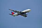 Delta Airlines Boeing 747-400 in flight on blue sky Photographed in Israel