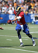 Los Angeles Rams rookie quarterback Jared Goff (16) hands off the ball on a running play during the Los Angeles Rams 2016 NFL training camp football practice held on Tuesday, Aug. 2, 2016 in Irvine, Calif. (©Paul Anthony Spinelli)
