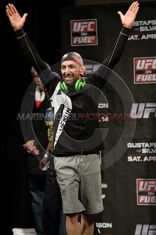 """STOCKHOLM, SWEDEN, APRIL 13, 2012: Reza Madadi steps on stage at the weigh-in for """"UFC on Fuel TV: Gustafsson vs. Silva"""" inside the Ericsson Globe Arena, Stockholm."""