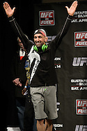 "STOCKHOLM, SWEDEN, APRIL 13, 2012: Reza Madadi steps on stage at the weigh-in for ""UFC on Fuel TV: Gustafsson vs. Silva"" inside the Ericsson Globe Arena, Stockholm."