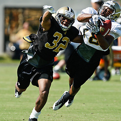 July 31, 2011; Metairie, LA, USA; New Orleans Saints rookie cornerback Johnny Patrick (32) defends against rookie wide receiver Michael Galatas (18)during training camp practice at the New Orleans Saints practice facility. Mandatory Credit: Derick E. Hingle