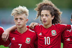 NEWPORT, WALES - Thursday, September 25, 2014: Wales' Keiran Proctor and Ethan Ampadu sing the national anthem before the Under-16's International Friendly match against France at Dragon Park. (Pic by David Rawcliffe/Propaganda)