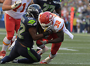 Aug 25, 2017; Seattle, WA, USA; Kansas City Chiefs running back Spencer Ware (32) suffers a knee injury after being tackled by Seattle Seahawks linebacker Terence Garvin (52) during a NFL football game at CenturyLink Field. The Seahawks defeated the Chiefs 26-13.