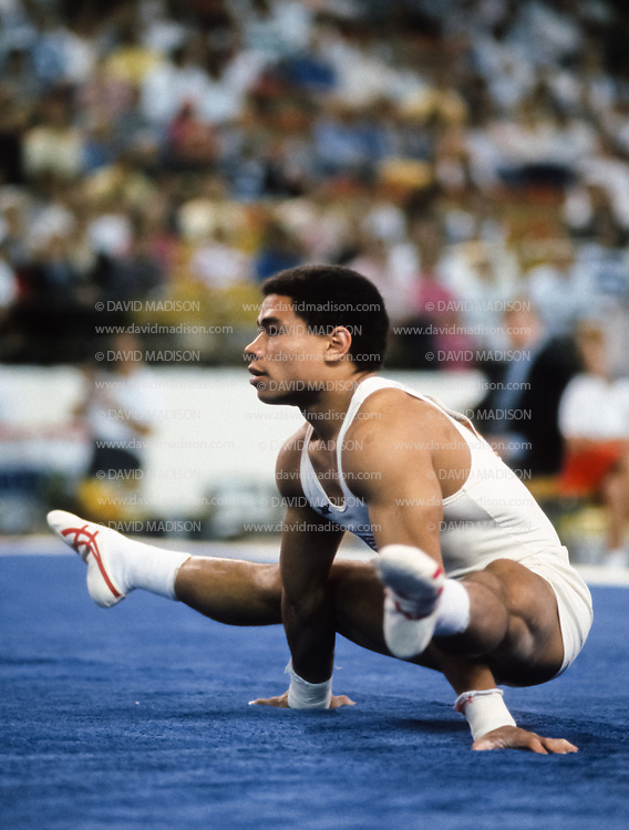 PHOENIX - APRIL 24:  Curtis Holdsworth of the United States competes in the floor exercise during a USA - USSR gymnastics meet on April 24, 1988  at the Arizona Veterans Memorial Coliseum in Phoenix, Arizona.  (Photo by David Madison/Getty Images)