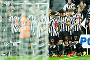 Newcastle United players celebrate their opening goal (1-0) scored by Mikel Merino (#23) of Newcastle United during the Premier League match between Newcastle United and Crystal Palace at St. James's Park, Newcastle, England on 21 October 2017. Photo by Craig Doyle.
