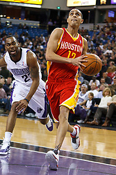 March 7, 2011; Sacramento, CA, USA;  Houston Rockets shooting guard Kevin Martin (12) dribbles past Sacramento Kings guard Marcus Thornton (23) during the first quarter at the Power Balance Pavilion.
