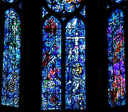 Stained glass windows created by Chagall with glassworker Charles Marq in 1974 depicting the history of Abraham and the last moments of the Earthly life of Christ (the Passion and the Resurrection) on the central window; the Virgin and the child on the left and the baptism of Clovis and the coronation of Saint Louis on the right, axial chapel, Notre-Dame de Reims (Our Lady of Rheims), pictured on February 15, 2009, 13th - 15th century, Roman Catholic Cathedral where the kings of France were crowned, Reims, Champagne-Ardenne, France.