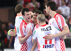 Team of Croatia (Domagoj Duvnjak (5) of Croatia) celebrate 21st Men's World Handball Championship 2009 Main round Group I match between National teams of France and Croatia, on January 27, 2009, in Arena Zagreb, Zagreb, Croatia.  (Photo by Vid Ponikvar / Sportida)