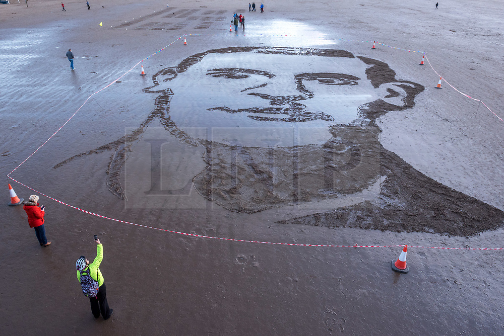 "© Licensed to London News Pictures. 11/11/2018. Weston-super-Mare, North Somerset, UK. Pages of the Sea on the Armistice Day centenary, 1918-2018, of the end of the First World War. Pictured: a sand portrait of Lieutenant Colonel John Hay Maitland Hardyman, designed by sand artists Sand In Your Eye,  drawn into the sand on Weston's beach to be washed away as the tide comes in. Lieutenant Colonel John Hay Maitland Hardyman, D.S.O. M.C. (28 September 1894 – 24 August 1918) was born in Bath, was an Officer in the Royal Flying Corps and was awarded for gallantry. In May 1918, aged only 23, he became the youngest lieutenant colonel in the British Army. In December 1914, he was accepted for officer training with the Royal Flying Corps (forerunner of the RAF) at Brooklands, Surrey, though eventually served with the Somerset Light Infantry. He was awarded the Distinguished Service Order for conspicuous gallantry and devotion to duty. After the enemy had penetrated allied lines, John went forward through a heavy barrage to rally the troops and repel repeated enemy attacks over two days and three nights. He encouraged them through ""coolness and absolute disregard of personal danger"" to maintain a tactically important position. He was killed in action at Bienvillers, France, and buried in the military cemetery there. He was killed in France aged 24. Pages of the sea was devised by film-maker Danny Boyle and held at over 30 beaches across the UK on 11th November. Each event centres around a drawing of a large-scale portrait of a casualty from the First World War, designed by local sand artists, which will be washed away as the tide comes in.<br /> Photo credit: Simon Chapman/LNP"