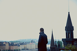 Back View of Man Admiring View of Stockholm
