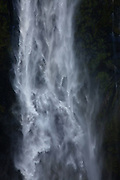 turbulent waterfall, Milford Sound, New Zealand