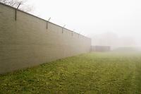 Brick wall surrounding field
